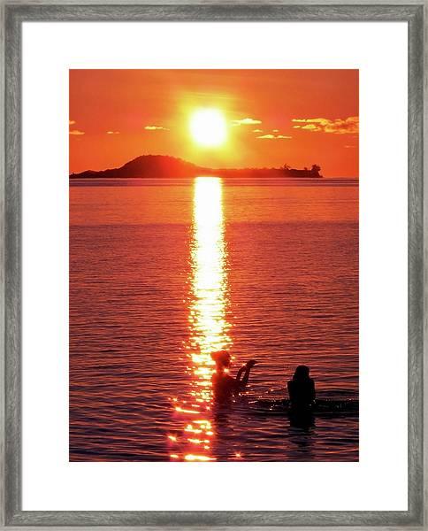 Bathing At Sunset Framed Print