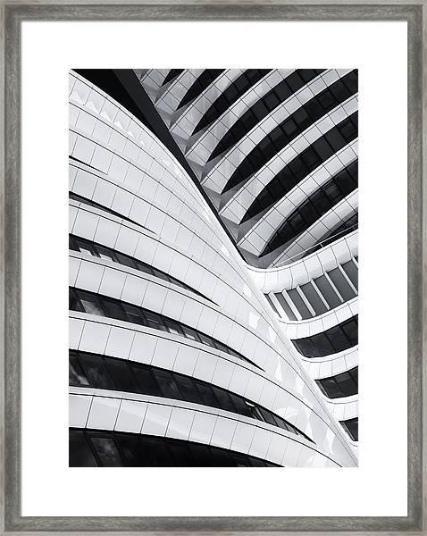 Battle Of The Curves Framed Print