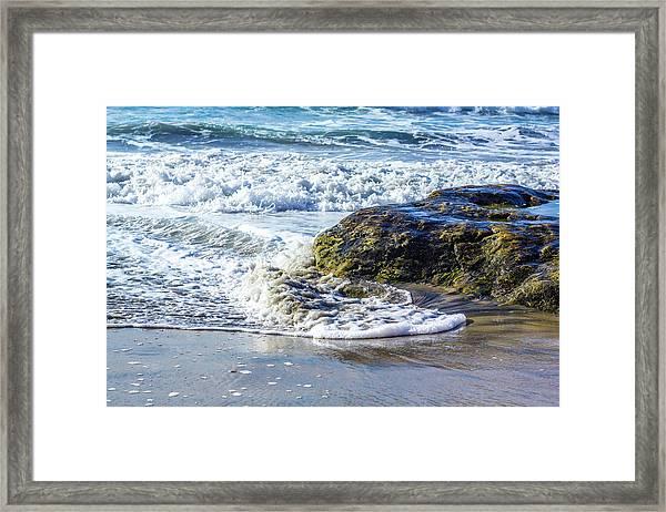 Wave Around A Rock Framed Print