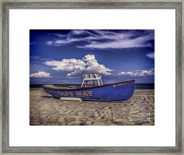 Beach And Lifeboat Framed Print