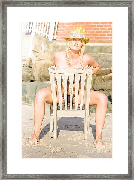 Beach Tourist Sitting On Wooden Chair Framed Print