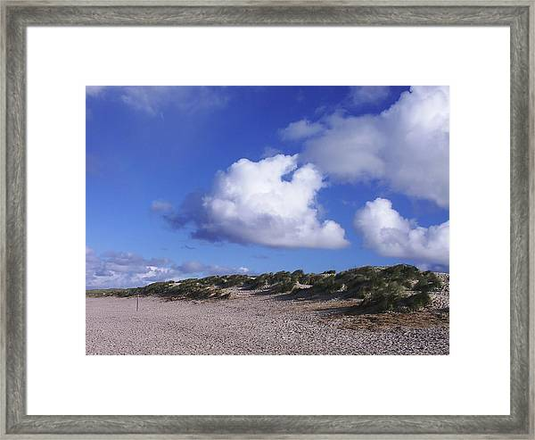Beach With Clouds Framed Print by Sascha Meyer