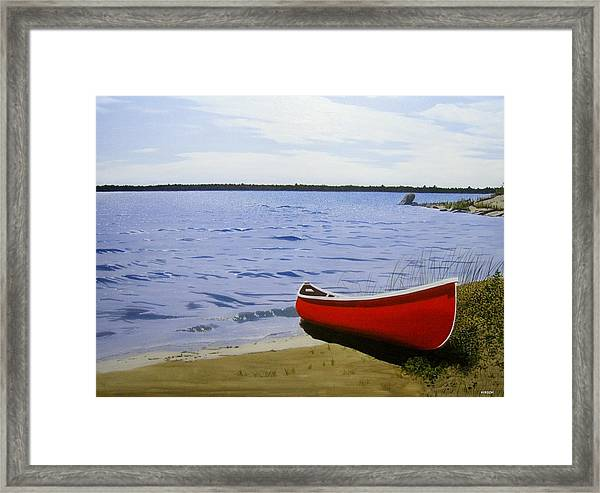 Beaultiful Red Canoe Framed Print