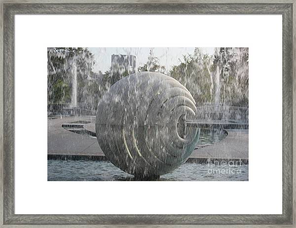 Behind The Water Framed Print