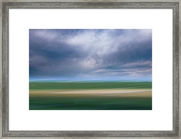 Below The Clouds Framed Print
