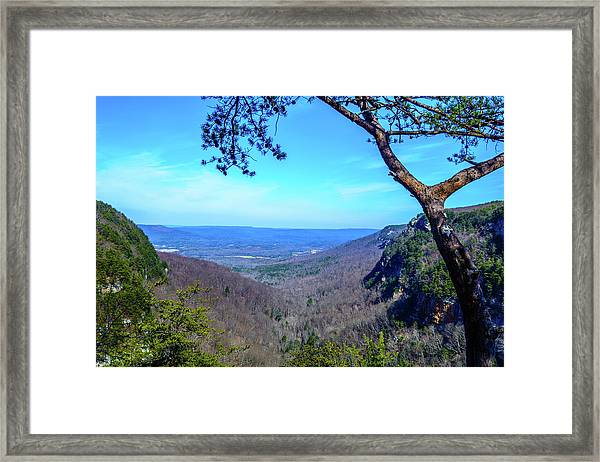 Between The Cliffs Framed Print