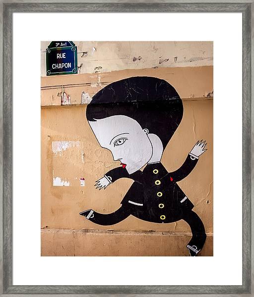 Big Head On Rue Chapon Framed Print
