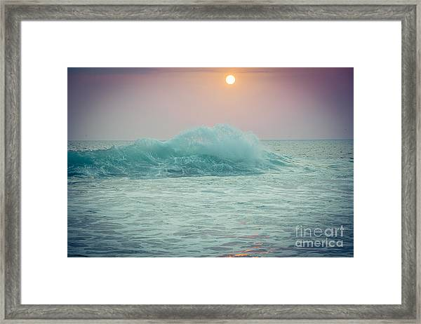 Framed Print featuring the photograph Big Ocean Wave At Sunset With Sun by Raimond Klavins