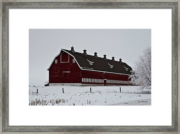 Big Red Barn In The Winter Framed Print