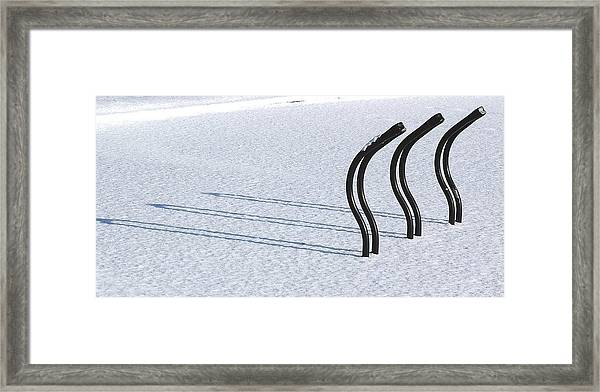 Bike Racks In Snow Framed Print