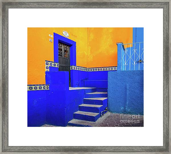 Blue And Yellow House Framed Print