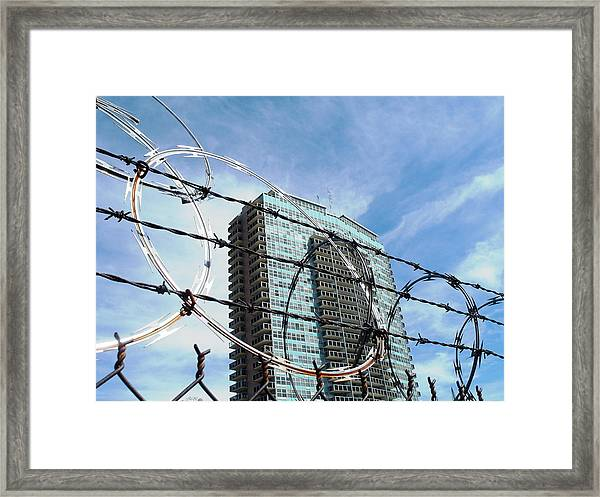 Blue Sky And Barbed Wire Framed Print