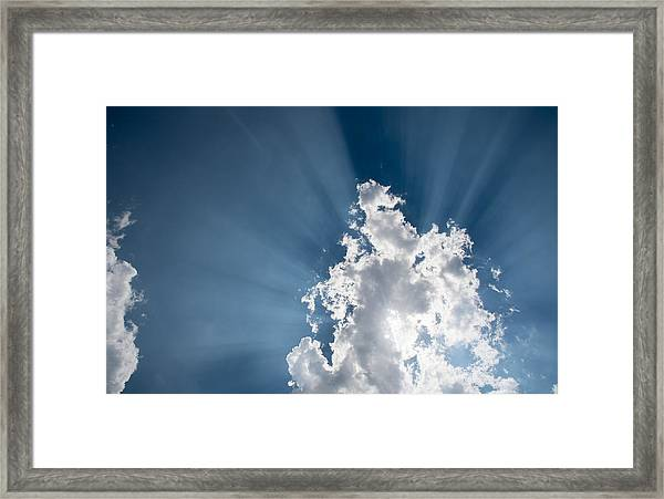 Blue Sky With White Clouds And  Sun Rays Framed Print