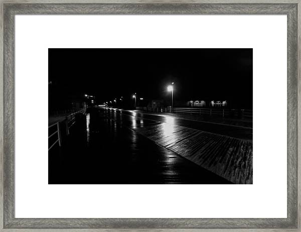 Boardwalk In The Still Of The Night Framed Print