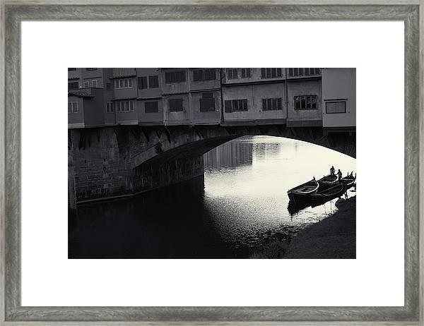 Boatmen And Ponte Vecchio, Florence, Italy Framed Print