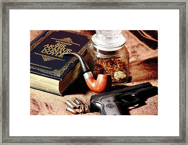 Books And Bullets Framed Print