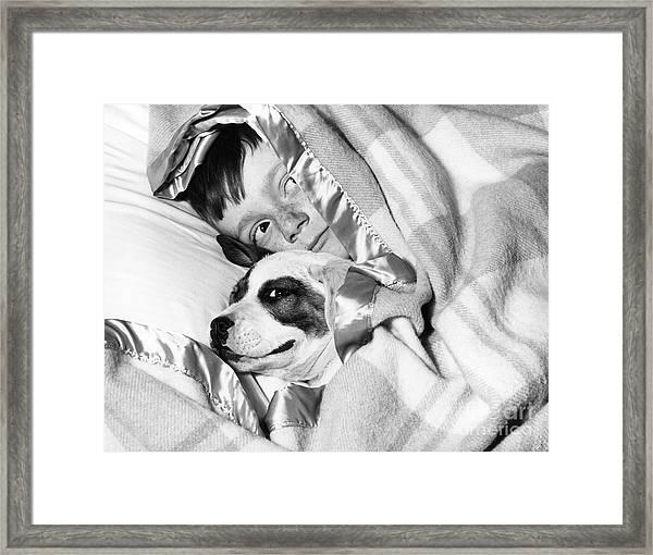 Boy And Dog Hiding Under Blanket Framed Print