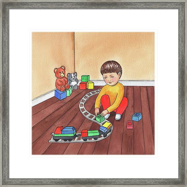 Boy Is Playing With Train Framed Print