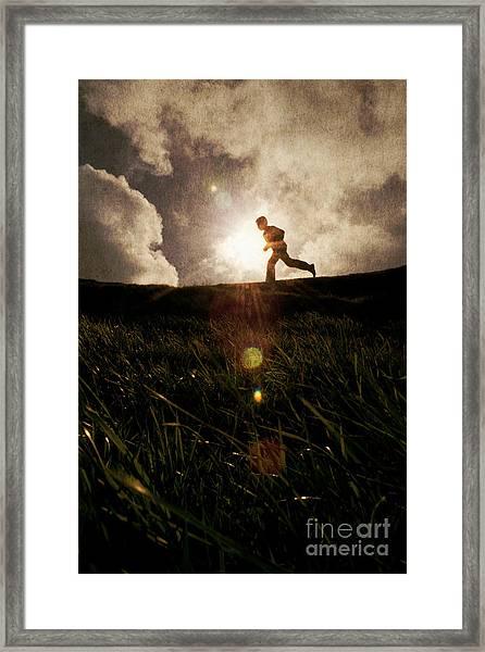 Boy Running Framed Print