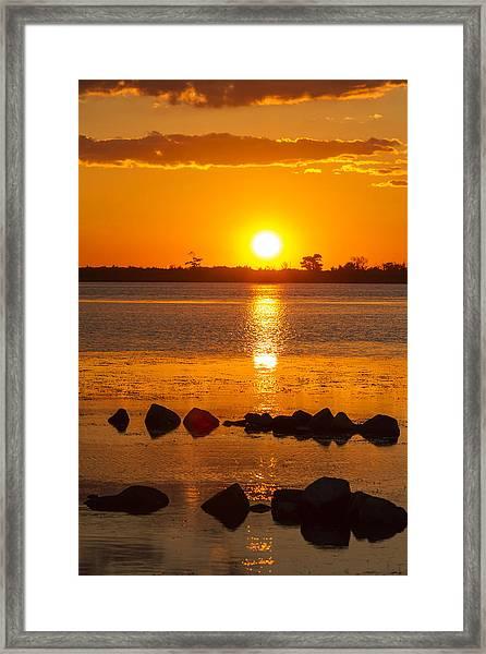 Breakwater Sunset Framed Print