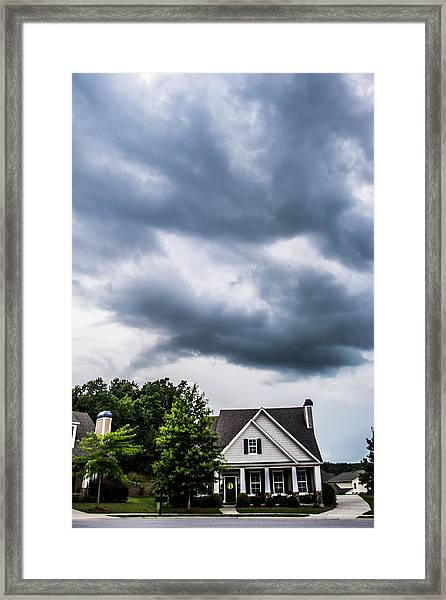 Brewing Clouds Framed Print