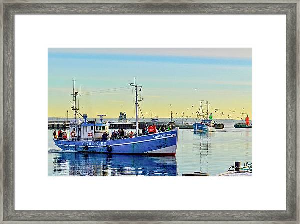 Bringing In The Day's Catch Framed Print