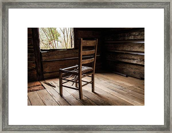 Broken Chair Framed Print