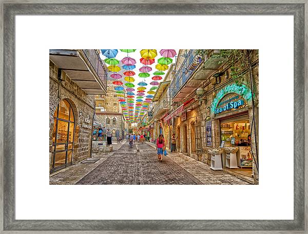 Brollies Over Jerusalem Framed Print