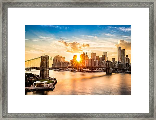 Brooklyn Bridge And The Lower Manhattan Skyline At Sunset Framed Print