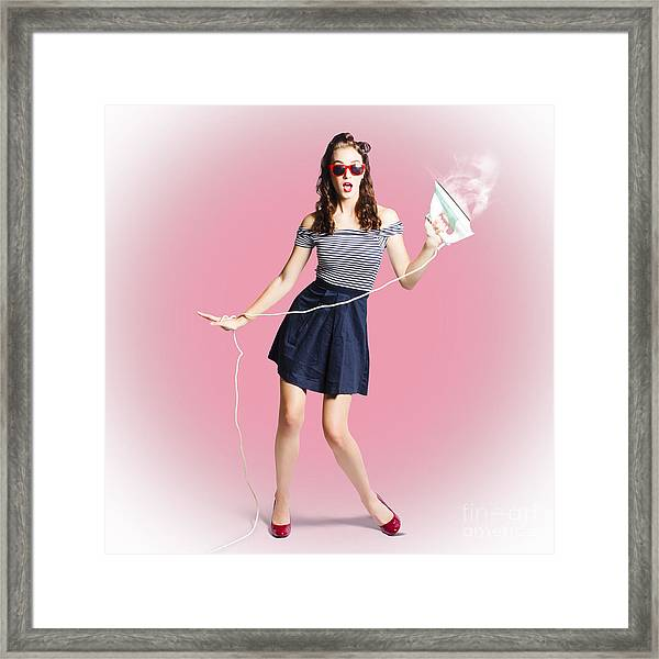 Brunette Pin-up Housewife With Iron Framed Print