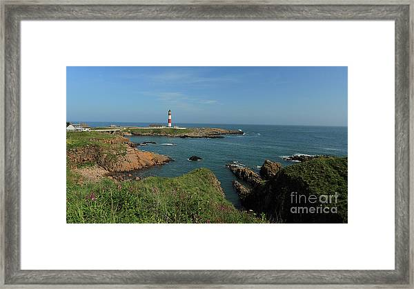 Buchan Ness Lighthouse And The North Sea Framed Print