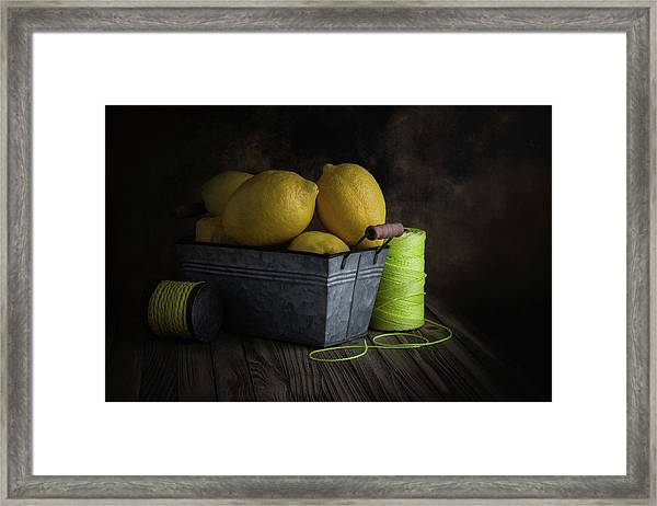 Bucket Of Lemons Framed Print