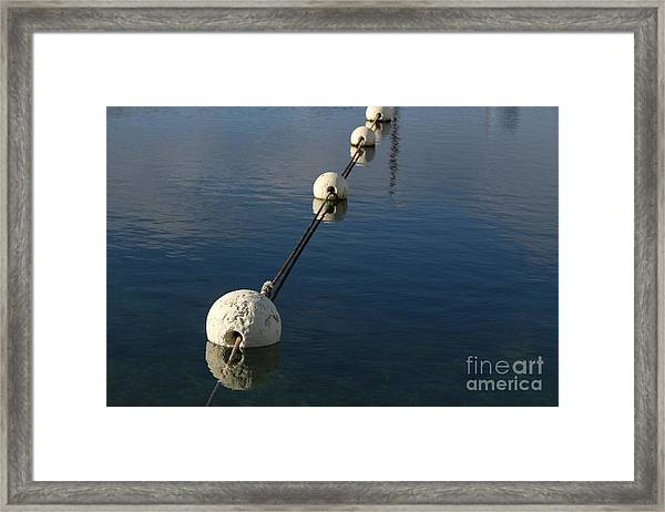 Buoys In Aligtnment Framed Print