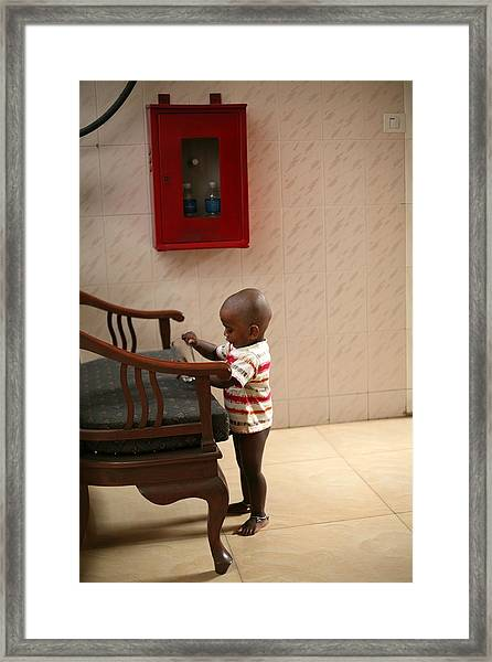 Busy Playing Framed Print