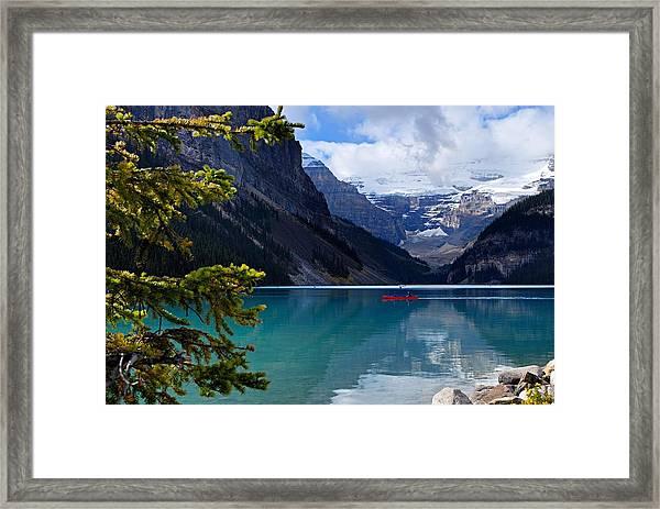 Canoe On Lake Louise Framed Print