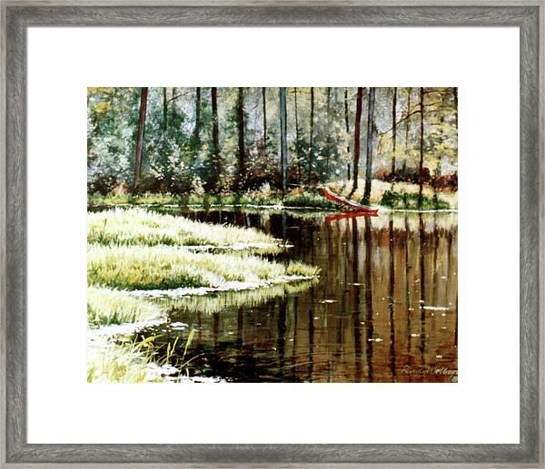 Canoe On Pond Framed Print
