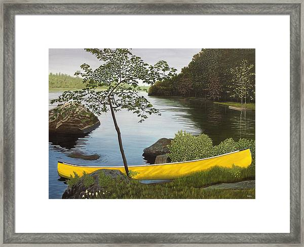 Canoe On The Bay Framed Print