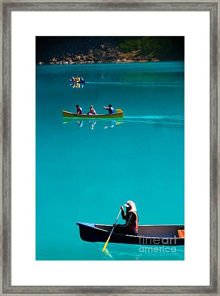 Canoeing On Glaciel Waters Framed Print