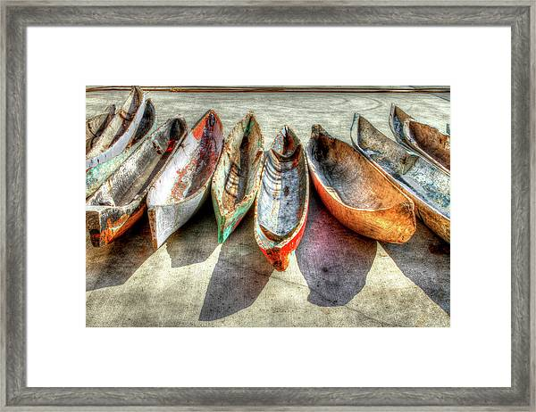 Framed Print featuring the photograph Canoes by Debra and Dave Vanderlaan