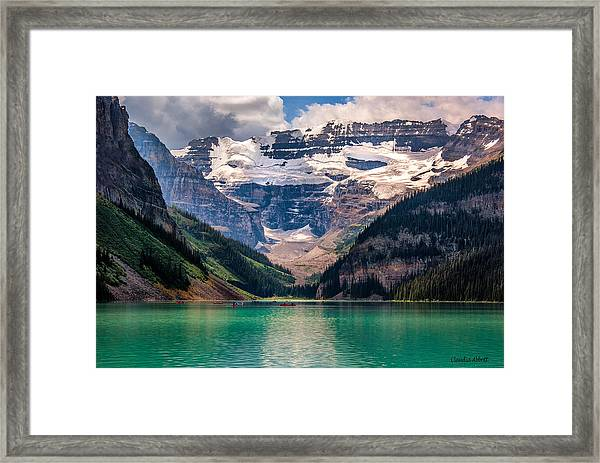 Framed Print featuring the photograph Canoes On Lake Louise by Claudia Abbott