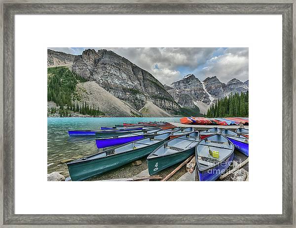 Canoes On Moraine Lake  Framed Print