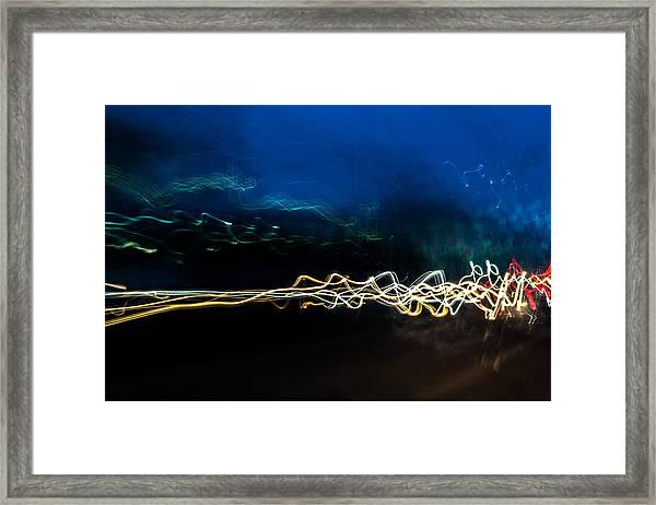 Car Light Trails At Dusk In City Framed Print
