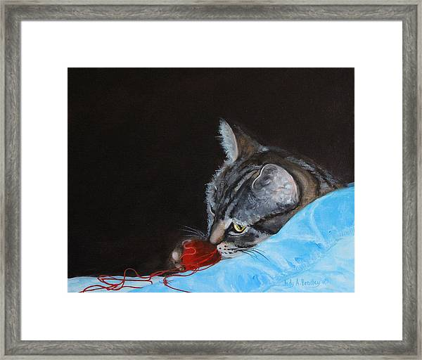 Cat With Red Yarn Framed Print