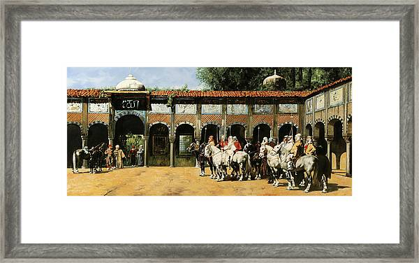 Cavalieri In Cortile Framed Print