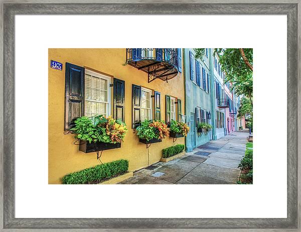 Charleston's Rainbow Row Framed Print by Drew Castelhano