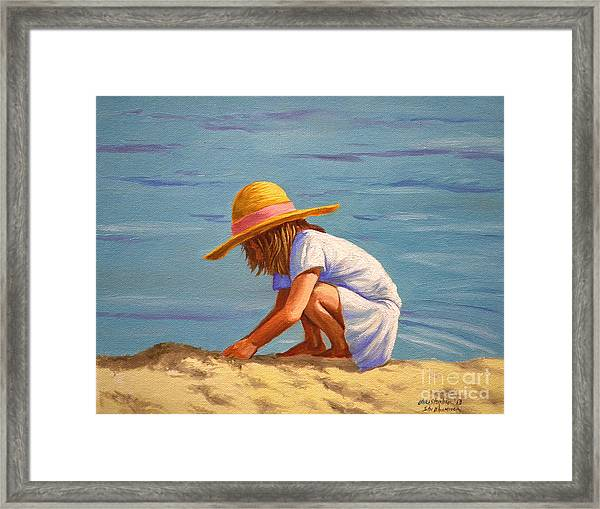 Child Playing In The Sand Framed Print