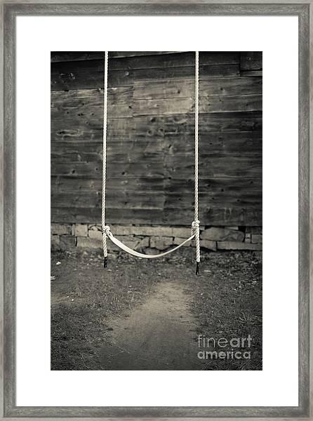 Child's Swing On An Old Farm Framed Print