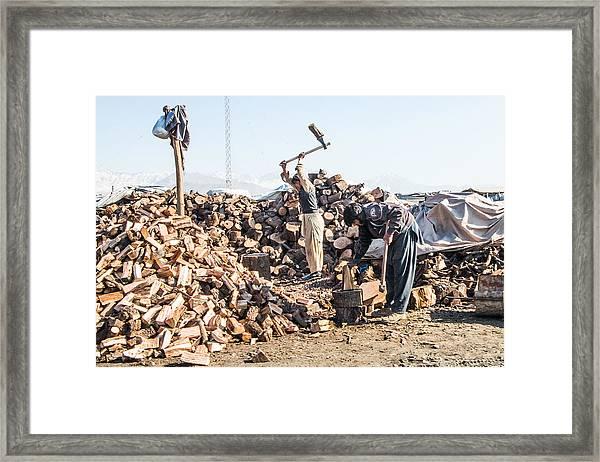 Chopping Wood Framed Print