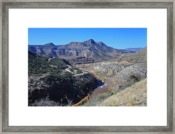 Clear And Rugged Framed Print