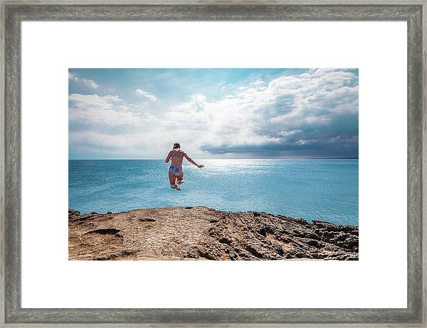 Framed Print featuring the photograph Cliff Jumping by Break The Silhouette